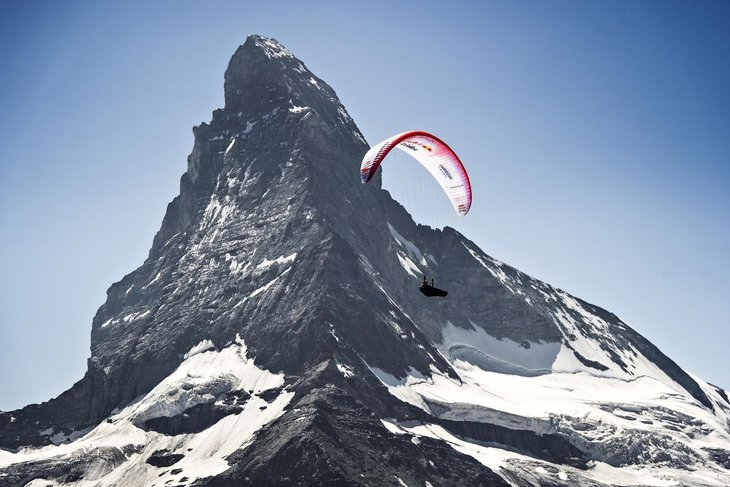Chrigl Maurer of Switzerland performs in front of the Matterhorn at the Red Bull X-Alps, Zermatt, Switzerland on July 10 2015.