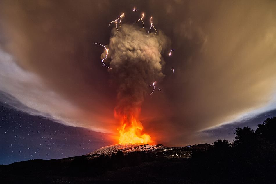 03 Dec 2015, Catania, Catania Province, Sicily, Italy, Italy --- Catania, Italy. 3rd December 2015 -- A so-called dirty thunderstorm with volcanic lightning seen as Mount Etna erupts. The weather phenomenon is related to the production of lightning in a volcanic plume. The image was captured by merging five separate images in sequence. -- Explosions and ash emissions were seen from Mount Etna's Voragine crater. The Voragine was formed inside the volcano's central crater in 1945. Its last eruptive activity dates back to 2013. --- Image by © Marco Restivo/Demotix/Corbis