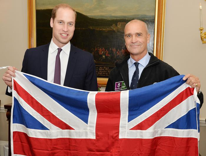 FILE - This is a  Oct. 19, 2015  file photo dated 19/10/15 of former Army officer Henry Worsley, right, with Britain's Prince William as they hold the British flag in London.  A British adventurer Henry Worsley has died after suffering exhaustion and dehydration while attempting to cross the Antarctic alone. Former army officer  Worsley was just 30 miles (48 kilometers) from the end of the almost 1,000-mile (1,600 kilometer) trek when he called for help and was airlifted off the ice Friday Jan. 22, 2015 . (John Stillwell/PA via AP) UNITED KINGDOM OUT  NO SALES NO ARCHIVE