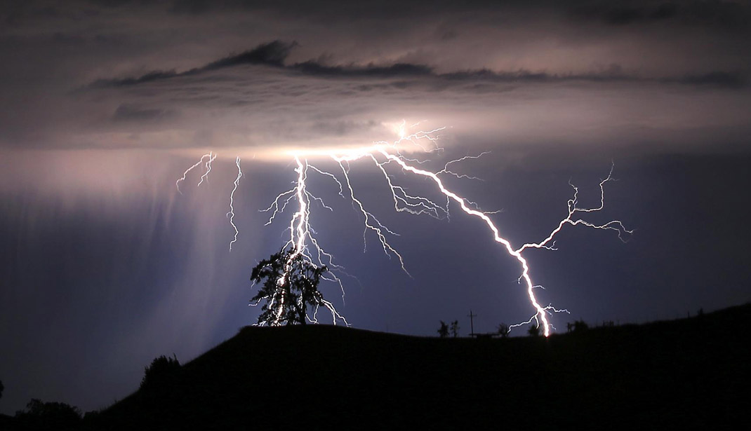 Lightning strikes above the Geysers area of northern Sonoma County, early Thursday, July 4, 2013 near Geyserville Calif.  (AP Photo/Santa Rosa Press Democrat, Kent Porter)  MANDATORY CREDIT: KENT PORTER/SANTA ROSA PRESS DEMOCRAT