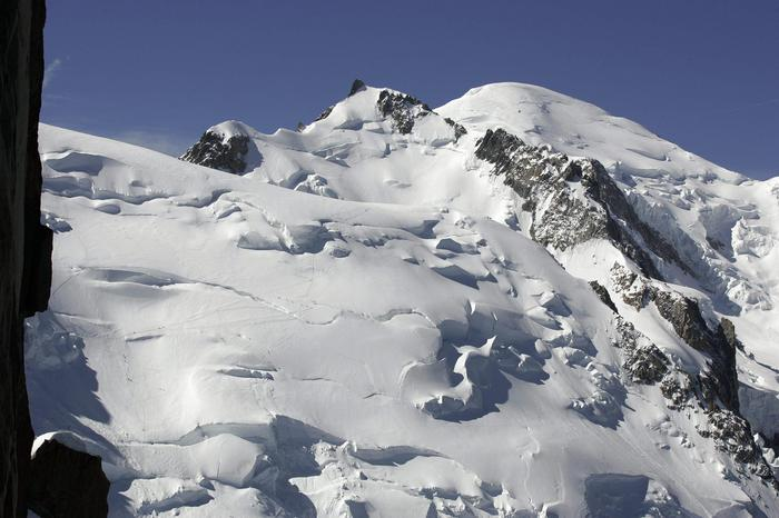 epa03304525 (FILE) A file photo dated 01 June 2005 shows the 'Mont Maudit', (C) and the 'Mont Blanc' (R) main peak at 4,808 meters above sea level, in Chamonix, France. At least nine climbers have been killed and eight injured in an avalanche near the Chamonix ski resort, in France, 12 July 2012. EPA/ARNO BALZARINI