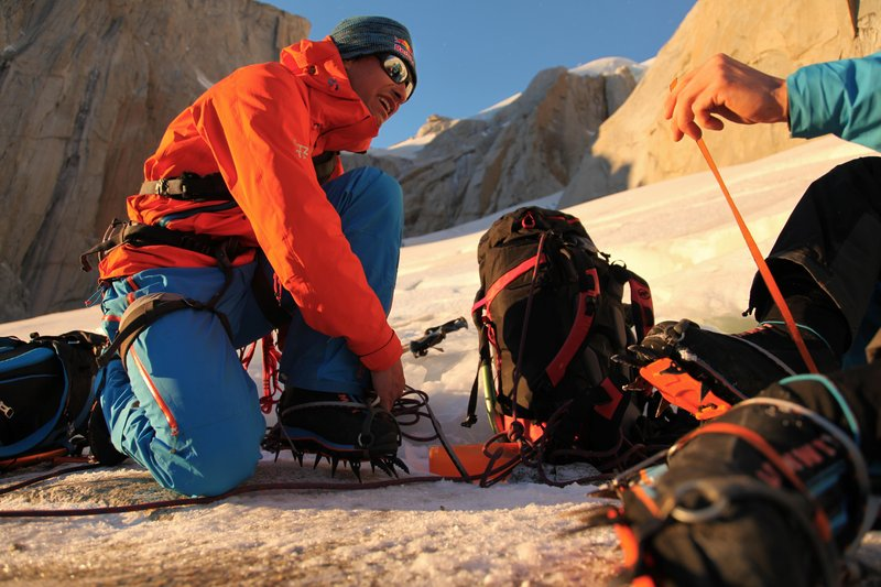 David Lama putting on his crampons to climb up to Col de la Patienca for their attempt on Cerro Torre in Patagonia, Argentina.