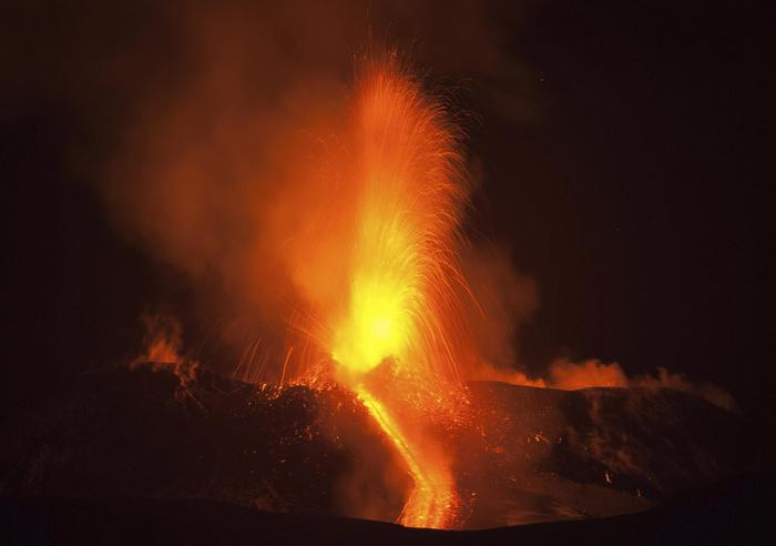 Mount Etna, Europe's most active volcano, spews lava during an eruption, near the Sicilian town of Catania, southern Italy, early Tuesday, Feb. 28, 2017. The eruption was not dangerous and the airport of Catania is still open and fully operating. (ANSA/AP Photo/Salvatore Allegra)