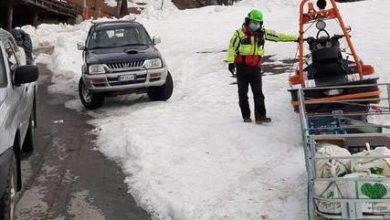 Photo of In montagna la spesa arriva in motoslitta col Soccorso Alpino